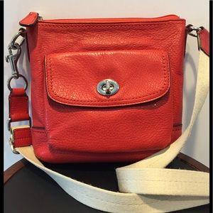 Coach orange pebble leather crossbody bag